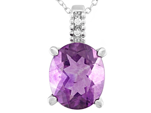 Photo of 4.68ct Oval Purple Fluorite With .02ctw Round White Zircon Sterling Silver Pendant With Chain