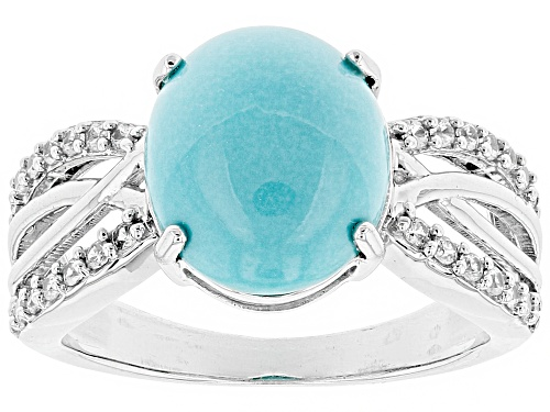 Photo of 12x10mm Oval Sleeping Beauty Turquoise And .28ctw Round White Zircon Rhodium Over Silver Ring - Size 7