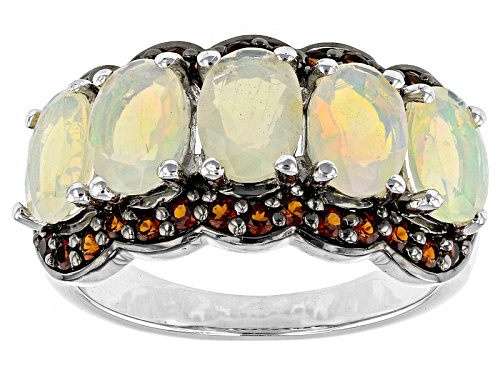 Photo of 2.44ctw Oval Ethiopian Opal And .70ctw Round Vermelho Garnet™ Sterling Silver Ring - Size 5