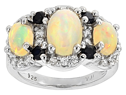 Photo of 1.65ctw Oval Ethiopian Opal, .34ctw Blue Sapphire And .50ctw White Zircon Silver 3-Stone Ring - Size 8