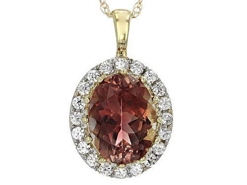 Photo of .90ct Oval Oregon Sunstone With .20ctw Round White Zircon 10k Yellow Gold Pendant With Chain.