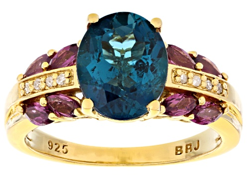 2.72ct London Blue Topaz With .68ctw Rhodolite & .03ctw Diamond Accent 18k Gold Over Silver Ring - Size 11