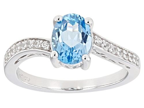 Photo of Pre-Owned 1.15ctw Oval Swiss Blue Topaz with .48ctw Lab Created White Sapphire 10K White Gold Ring - Size 9.5