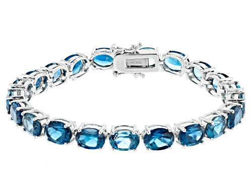 Photo of Pre-Owned 27.00ctw Oval London Blue Topaz Rhodium Over Sterling Silver Tennis Bracelet - Size 7.25