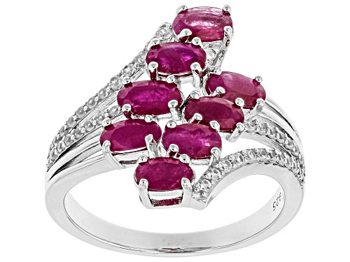 Photo of Pre-Owned 1.71ctw Oval Burmese Ruby & .24ctw Round White Zircon Rhodium Over Sterling Silver Bypass - Size 10