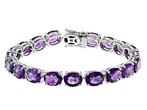 Photo of Pre-Owned 28.98ctw Oval African Amethyst Rhodium Over Sterling Silver Tennis Bracelet - Size 7.25