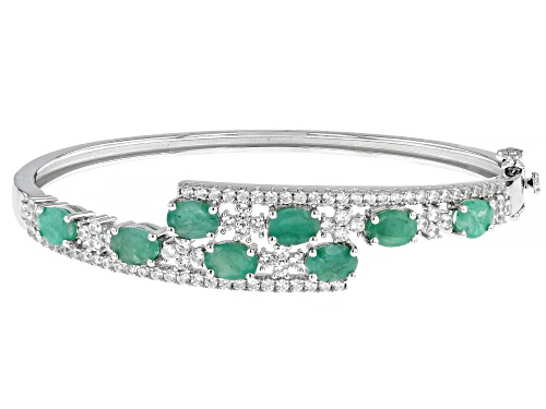 Photo of Pre-Owned 5.5ctw Green Emerald And White Zircon Rhodium Over Sterling Silver Bypass Bracelet - Size 7.25