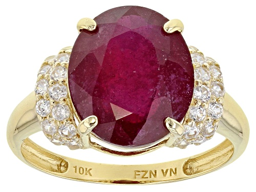 Photo of Pre-Owned 6.30ct Oval Mahaleo® Ruby Solitaire With .69ctw Round White Zircon 10k Yellow Gold Ring - Size 6