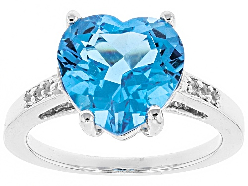 Photo of Pre-Owned 5.65ct heart shape Swiss blue topaz with .05ctw White topaz sterling silver ring - Size 6