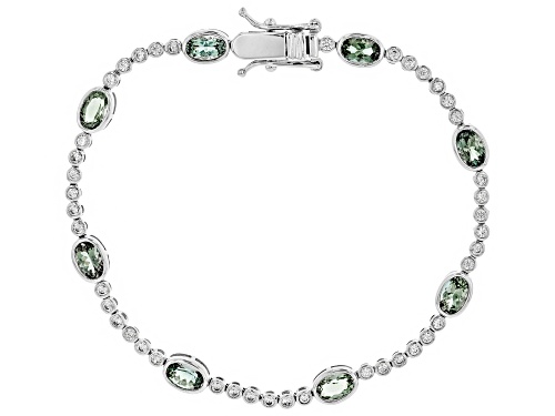 Pre-Owned 3.20ctw oval Oregon green sunstone with 1.22ctw round white zircon 10K white gold bracelet - Size 7.25