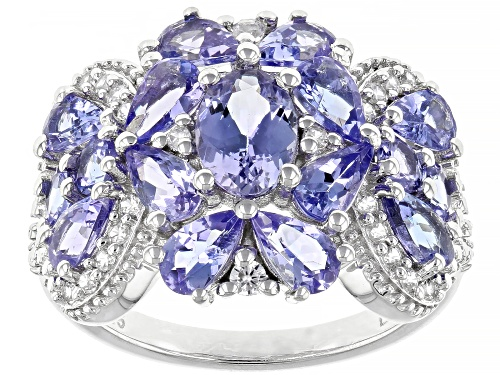 Photo of Pre-Owned 3.25ctw Mixed Shape Tanzanite With .24ctw White Zircon Rhodium Over Silver Cluster Band Ri - Size 5