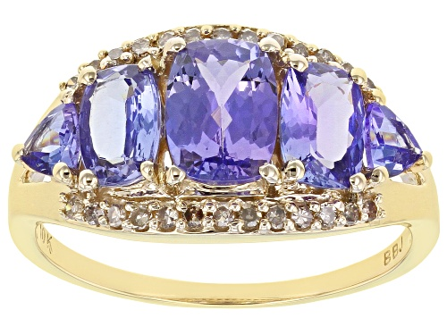 Photo of Pre-Owned 1.59ctw Tanzanite With .18ctw Round Champagne Diamond 10k Yellow Gold 5-Stone Band Ring - Size 10