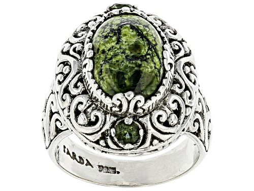 Photo of Pre-Owned Artisan Collection Of Bali™ 14x10mm Oval Serpentine And .18ctw Moldavite Silver Ring - Size 9