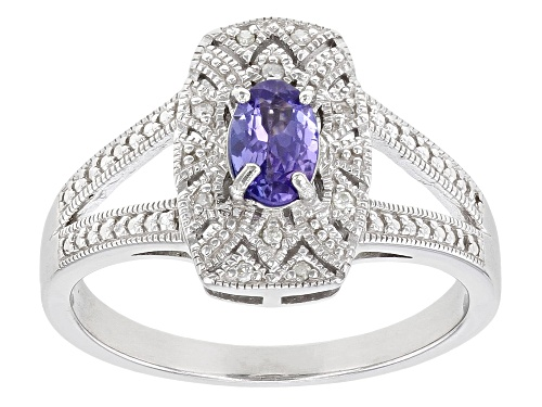Photo of Pre-Owned .38ctw Oval Tanzanite With .03ctw Round White Diamond Rhodium Over Sterling Silver Ring - Size 8