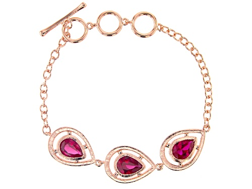 Photo of Pre-Owned Timna Jewelry Collection™ 5.23ctw Pear Shape Lab Created Ruby, Copper 3-Stone Bracelet - Size 7.5