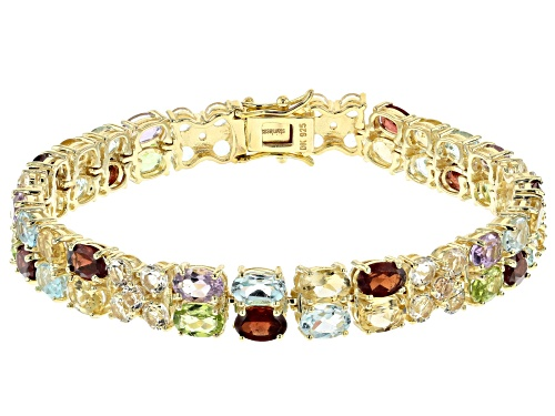 Photo of Pre-Owned 26.22ctw round, oval topaz, peridot, garnet, citrine, amethyst 18k gold over silver bracel - Size 7.25