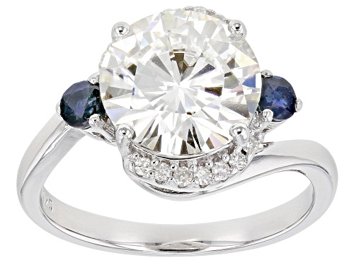 Photo of Pre-Owned MOISSANITE FIRE(R) 3.74TW DEW ROUND AND .35CTW ROUND BLUE SAPPHIRE PLATINEVE(TM) RING - Size 7