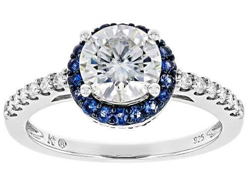 Photo of Pre-Owned MOISSANITE FIRE(R) 1.44CTW DEW ROUND AND .32CTW ROUND BLUE SAPPHIRE PLATINEVE(R) RING - Size 7