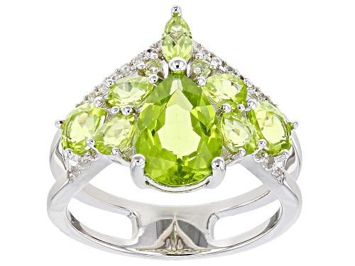 Photo of Pre-Owned 3.13ctw Mixed Shape Manchurian Peridot(TM) With .09ctw White Zircon Rhodium Over Silver Ri - Size 6