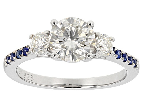 Photo of Pre-Owned Moissanite Fire® 1.52ctw Dew And .22Ctw Blue Sapphire Platineve™ Ring - Size 11
