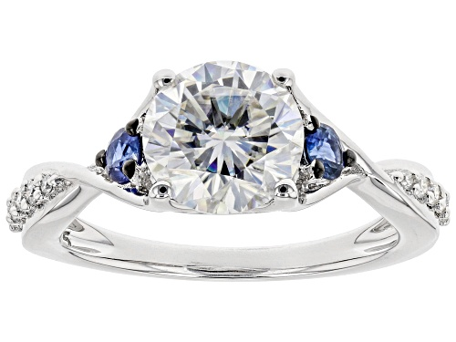 Photo of Pre-Owned Moissanite Fire® 2.00ctw Dew And .33ctw Blue Sapphire Platineve™ Ring - Size 10
