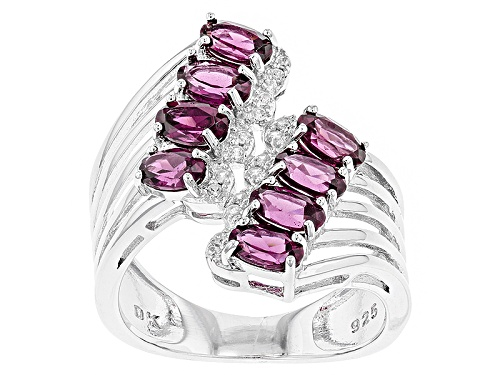 Photo of Pre-Owned 2.25ctw Oval Raspberry color Rhodolite And .05ctw Round White Zircon Silver Bypass Ring - Size 5