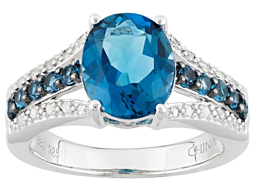 Photo of Pre-Owned 3.23ctw Oval And Round London Blue Topaz With .10ctw White Diamond Sterling Silver Ring - Size 5