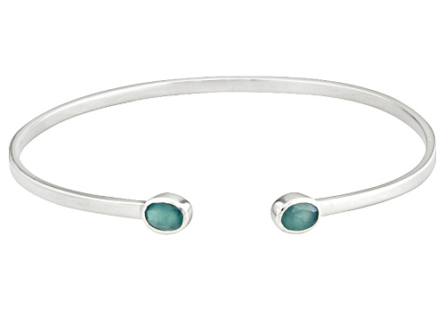 Photo of Pre-Owned Exotic Jewelry Bazaar™ 1.25ctw Oval Grandidierite Sterling Silver Bangle Bracelet - Size 8