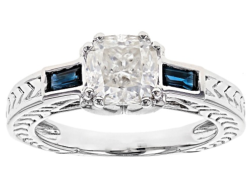 Photo of Pre-Owned Moissanite Fire® 1.30ct Dew Cushion Cut With .34ctw Baguette Blue Sapphire Platineve™ Ring - Size 7