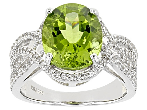 Photo of Pre-Owned 4.50ctw Oval Green Peridot With 0.57ctw Round White Zircon Rhodium Over Silver Ring - Size 9