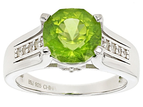 Photo of Pre-Owned 2.80ct Round Manchurian Peridot™ And .23ctw Round White Zircon Sterling Silver Ring - Size 10