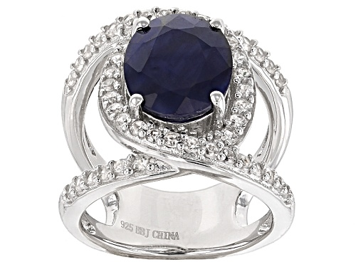 Photo of Pre-Owned 3.40ct Oval Blue Sapphire With .86ctw Round White Zircon Sterling Silver Ring - Size 10