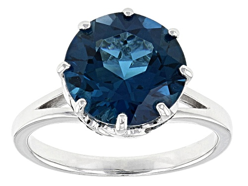 Photo of Pre-Owned 5.19ct Round London Blue Topaz And .11ctw Round Blue Diamond Sterling Silver Ring - Size 11