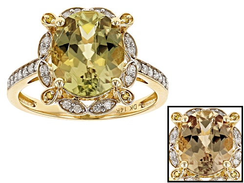 Photo of Pre-Owned 3.33ct Oval Turkish Diaspore With .18ctw Round White & .04ctw Yellow Diamond Accent 14k Go - Size 6