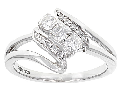 Photo of Pre-Owned Moissanite Fire® .49ctw Dew Cushion Cut And Round Platineve™ Ring - Size 7