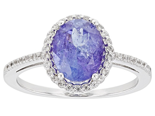 Photo of Pre-Owned 1.63ctw Oval Tanzanite & .17ctw Round White Zircon Rhodium Over Sterling Silver Halo Ring - Size 7