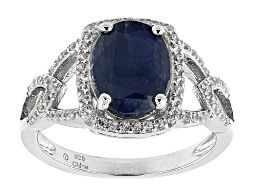 Photo of Pre-Owned 3.00ct Oval Blue Sapphire With .48ctw Round White Zircon Rhodium Over Sterling Silver Ring - Size 7