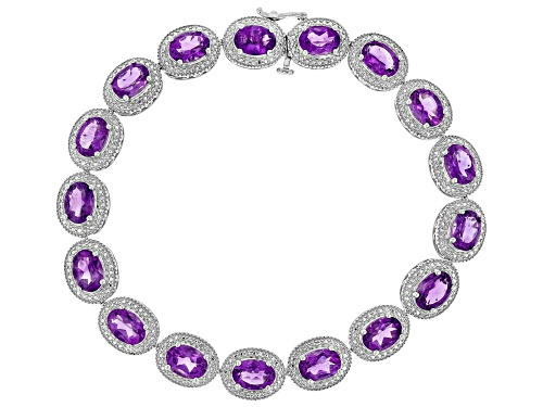 Photo of Pre-Owned 14.16ctw Oval Amethyst With Round White Diamond Accent Rhodium Over Sterling Silver Bracel - Size 7.5
