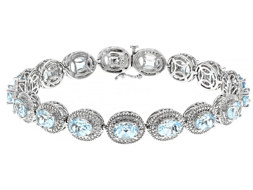 Photo of Pre-Owned 18.33ctw Oval Sky Blue Topaz With Round White Diamond Accent Rhodium Over Sterling Silver - Size 7.25