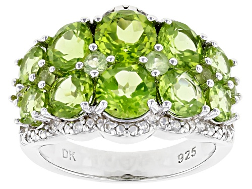 Photo of Pre-Owned 4.34ctw Round Manchurian Peridot(TM) With .15ctw Zircon Rhodium Over Silver Band Ring - Size 9