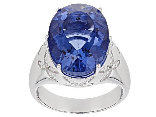 Photo of Pre-Owned 8.50ct Color Change Fluorite with .04ctw White Zircon Rhodium Over Sterling Silver Ring - Size 7