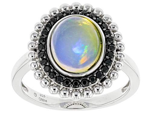 Photo of Pre-Owned 10x8mm Ethiopian Opal and 0.25ctw Black Spinel Rhodium Over Sterling Silver Ring - Size 7