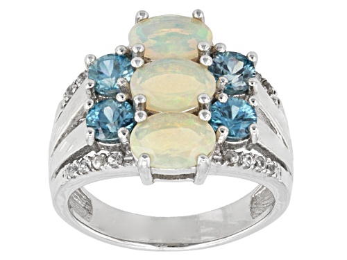 Photo of Pre-Owned 1.23ctw Oval Ethiopian Opal, 1.74ctw Round Blue Zircon And .13ctw Round White Zircon Silve - Size 7