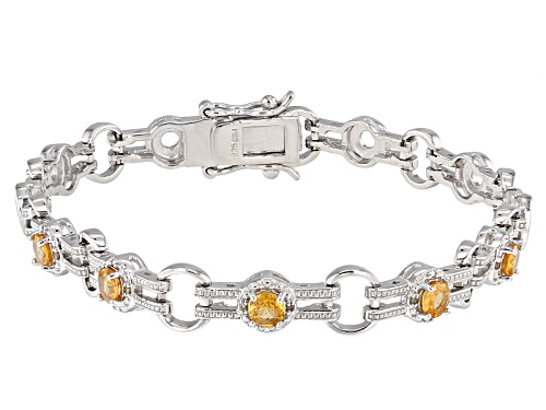 Photo of 1.35ctw Round Mandarin Garnet  And .03ctw Round Champagne Diamond Accent Silver Bracelet - Size 8