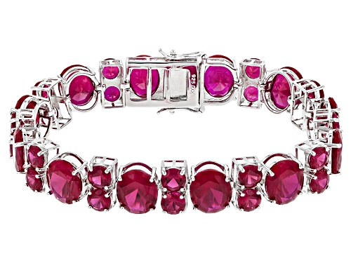 Photo of 74.97ctw Oval And Round Lab Created Ruby Sterling Silver Bracelet - Size 7.25