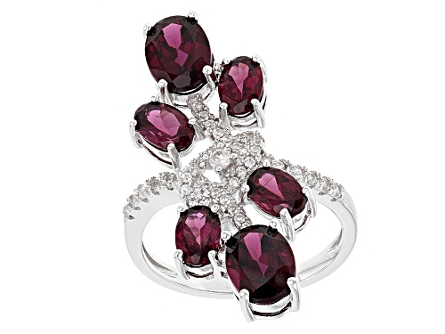 Photo of 4.55ctw Oval Raspberry color Rhodolite And .15ctw Round White Zircon Sterling Silver Bypass Ring - Size 5