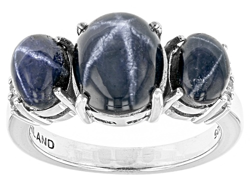 5.69ctw Oval Cabochon Blue Star Sapphire With .10ctw Round White Zircon Sterling Silver Ring - Size 11
