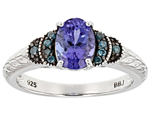 Photo of 1.10CT OVAL TANZANITE AND .08CTW ROUND BLUE DIAMOND ACCENT RHODIUM OVER SILVER RING - Size 10