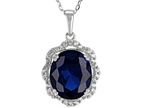 Photo of 4.05CT OVAL LAB CREATED BLUE SPINEL WITH .39CTW ROUND ZIRCON STERLING SILVER PENDANT WITH CHAIN