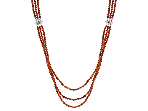 Photo of 108.36ctw faceted round hessonite garnet beads, three strand sterling silver necklace - Size 19